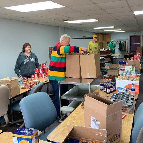 Volunteer Food Box Packing Karen Nick Preston Jim Lester